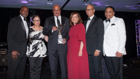 Honorees Gary and Denise Gardner of the Gary and Denise Gardner Family Fndtn. accepting their award w/ Michael Cox, Deborah Hand, Michael L. Lomax and Tyronne Stoudemire