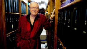 Hugh Hefner amid his 2,600 personal scrapbooks
