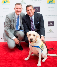 Tails in the City's Phillip Emigh and Bruce Haas with a CC service dog
