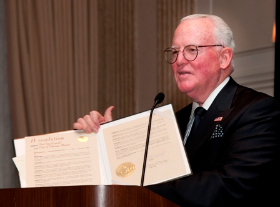 Alderman Burke presents a proclamation in honor of Ed Weil, Jr.