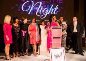 The stars of the video, survivors and those touched by breast cancer take the stage with Dr. Sheri Prentiss for an emotional moment in the evening