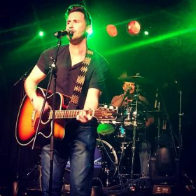 "Ryan Chiaverini sings at ""Concert for a Cause"" in memory of his brother"