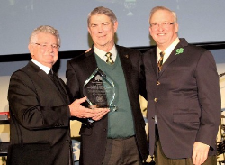 Honoree Dr. Joe Schmidt receives the Crystal Shamrock Award from past president Brother Konrad Diebold and board chair Bill McManaman