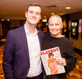 "Cooper signed by Playboy cover at world premiere of ""American Playboy: The Hugh Hefner Story."""