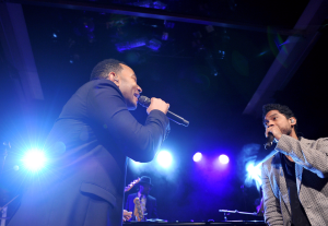 John Legend performs with Miguel