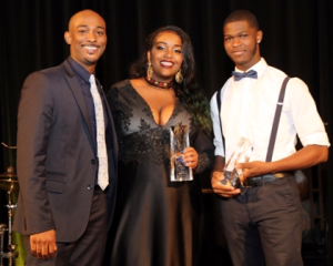 Damani Bolden (L) presented Rising Star Awards to Eva Maria Lewis and Adonis Perryman