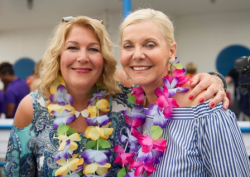 Beach Party emcee Lisa Dent with PAWS Chicago founder Paula Fasseas