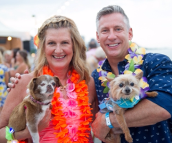 Beach Party co-chairs Michele Mistovich and Dr. Tony Kremer with Abigail and Chompers