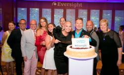 Cutting the 70th anniversary Eli's Cheesecake