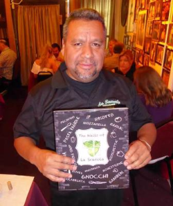 Co-author Armando Vasquez (along with Joey Mondelli) holds the first La Scarola book