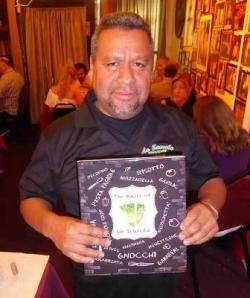 Co-author Armando Vasquez (along with Joey Mondelli) holds the first La Scarola book