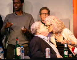 Chris Rock, Tim Kazurinsky look on as Wendt is kissed by his wife, Bernadette Birkett