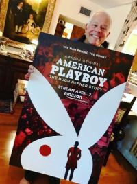 Chuck, my own American Playboy, holding my film premiere poster