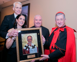 Chair couple Michael and Claire O'Grady, Monsignor Boland and Cardinal Cupich