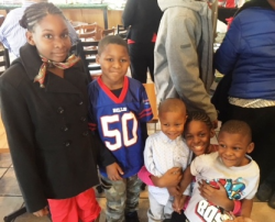 Happy kids at Fioretti's annual Christmas luncheon/ toy giveaway.