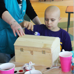 Lurie Children's patient paints and decorates box he gets to keep via 4Everly Adorned