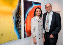 "Anita K. Sinha, Chair of SAIC's Board of Governors, with husband Prabhakant Sinha, alongside the piece ""Knowledge Comes with Death's Release IV-V, 2017"" by Beate Geissler & Oliver Sann"