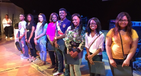 Excited scholarship winners during rehearsal