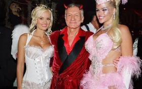 Holly, Hef and the late Anna Nicole Smith in a vintage photo.