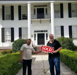 Chef Art Smith and Jesus Salgueiro celebrate the purchase of the Smith Mansion