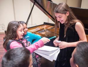 Child prodigy/pianist Daniela Liebman signs autographs