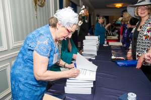"Chicago Chapter historian Peggy Forney Becker signs her book, ""Articles & Artifacts from the Archives."""