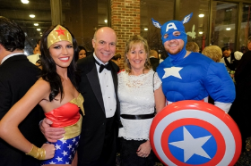 Karen and Ken Bauwens with Wonder Woman and Captain America