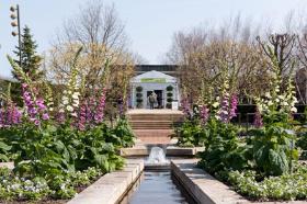 Entrance to the Antiques, Garden & Design Show Preview Evening through the Heritage Garden
