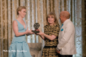 ScarJo receives her award from Ellen Sandor and Walter Massey