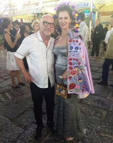 Designer Domenico Dolce and Leslie Zemeckis relaxing post show
