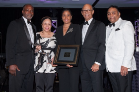 Honoree Diane Dinkins Carr accepting the award for her and her husband Louis Carr w/ Michael Cox, Deborah Hand, Michael L. Lomax and Tyronne Stoudemire
