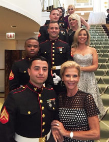 Finale models Sherry Lea Holson, Sharyl Mackey, Mary Lasky and Darby Hills with their handsome Marine escorts