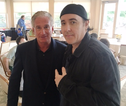 Event organizer/co-host Jerry Lasky with John Cusack