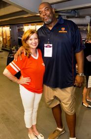 "Museum trustee Liz Sharp with former Chicago Bear James ""Big Cat"" Williams"
