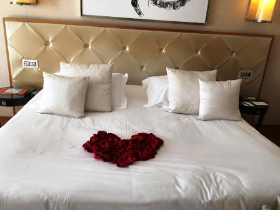 Romantic flowers decorate their bed at the Hermitage in Monte-Carlo