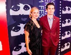 Filmmaker Damien Chazelle and guest Olivia Hamilton on the red carpet