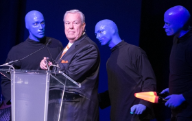 Event host Bill Kurtis with Blue Man Group