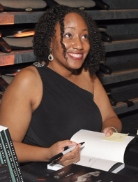 Amina Gautier signs books for fans