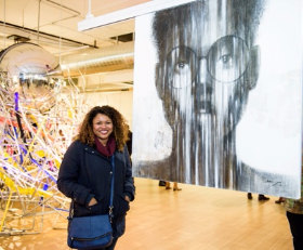 Bianca Marks beside artwork by Stephen Olalekan