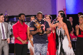 Celebrity superstar Jason Davis accepts trophy with his Arthur Murray Dance partner Basia Kaczmarek