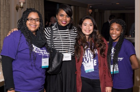 MASK founder Tamar Manasseh with members of Teen Squad
