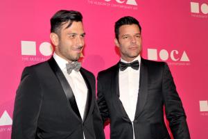 Artist Jwan Yosef (L) and singer Ricky Martin
