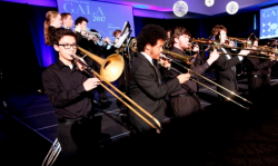 """Merit students perform Seventy-Six Trombones from """"The Music Man"""" to close out the evening"""