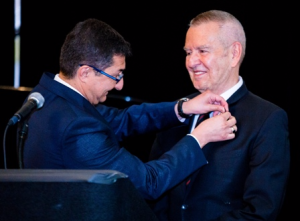 "Michael Kutza is ""pinned"" by Italian Consul General Giuseppe Finocchiaro"