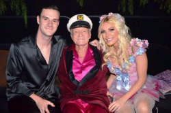 Cooper, Hef and Crystal Hefner at a past MND party