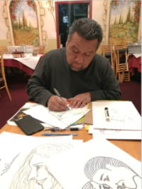 Author/restaurateur Armando Vasquez works on his T-shirt designs!