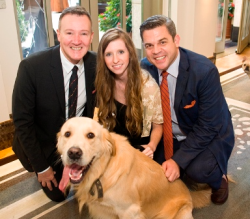 Phillip Emigh, Molly Schulz and Bruce Haas with furry friend