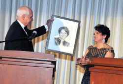 PAMS president Dr. Kornelia Krol is surprised with a portrait presented by Dr. Marek Rudnicki