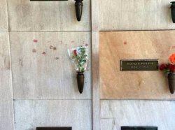 Kisses for Hef at his final resting place next to Marilyn Monroe
