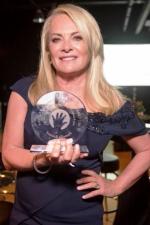 Designer Pamella Roland holds her much deserved award from Children's Service Board